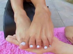 Sexy lubed up footjob outdoors