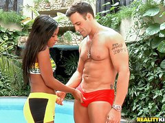 Attractive long haired latina brunette Samira Ferraz with tan skin is hungry for dick. She takes dude's dick between her tits and sucks it by the pool before doggy style fucking.