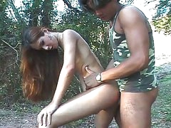 Amateur tranny roams the forest for military cock