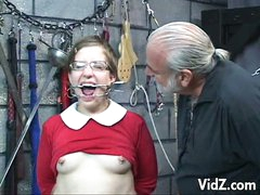 This cute but daring slutty bitch in eyeglasses is one of this evil master's next victims. She is forced to with stand violent orgasms while her fragile body gets tortured. One is a screw is used on her very tender nipples and a lot more. What a memorable