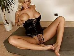 Stunning busty blonde in corset with foot fetish teases and poses