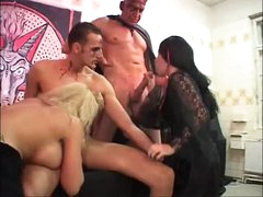 Strange foursome with tattooed and pierced cuties