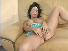 Raven haired busty Sabrina Dotee widens her legs and strokes her hairless pussy like crazy in this solo scene. She can't stop rubbing her bare snatch. Sabrina Dotee puts her hands on her fake boobs from time to time.