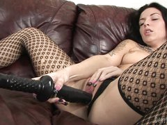 Aria Aspen shoves her huge dildo deep in her moist slot