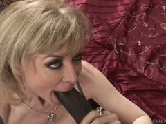 Nina Hartley is a good looking busty mature slut that is hungry for big black dick. She takes nice size dark sausage in her experienced mouth with big desire.