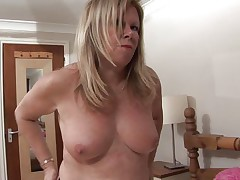 european mature takes off her panties