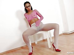 sexy brunette covered in nylon masturbating on chair