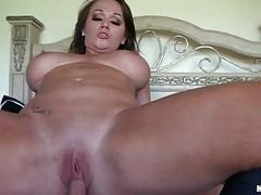 Sensual brunette milf with big balloons rides hard weiner in bedroom