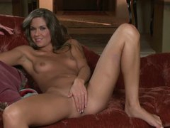 Adrienne Manning is with skinny figure removes her blue panties to play with her snatch. Cute dark brown with small wobblers and lengthy legs has a good tine masturbating on the sofa with her high heels on.