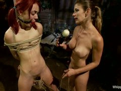 Naked pigtailed redhead Zoe Voss gets tied up and fucked hard by big titted lesbian domina Felony. Crazy domme fucks yielding Zoe Voss in the ass.