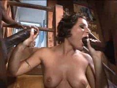 Curly hair girl on her knees sucking black cocks
