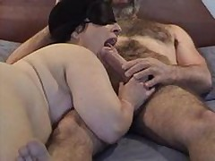 masked chubby sucks cock