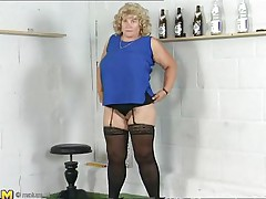 blonde mature woman playing alone