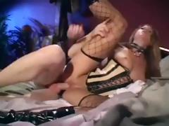 Sexy brunette in sexy fishnet stockings gets fucked in the ass