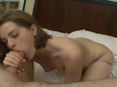 Glamorous girl sucks and fondles in hotel bedroom