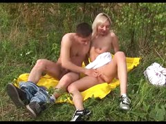 Cute couple fucking in a field outdoors