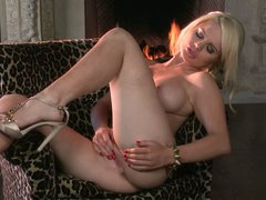 Breathtaking blond beauty Alexis Ford shows off her killer boobs and toys her snatch in another sexy solo video. She strips out of her lingerie and masturbates by the fireplace.