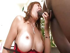 Busty mom Desi Foxx acquires it from a large black penis