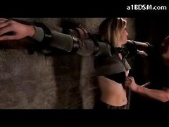 Blonde Gal Tied To Cross Abdomen And Ass Spanked Tits Rubbed In The Dungeon