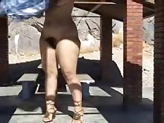 Anonymous plumper with a bubble butt dances on table outside