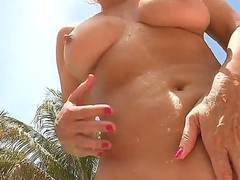 Wicked and voluptuous Jodi West is giving man a wild penis sucking by the pool