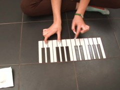 Cute teen plays piano and pussy on the floor