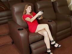 blonde slut masturbates on an armchair