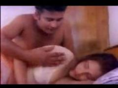 Indian couple having sex on the bed as he kisses her tits on cam
