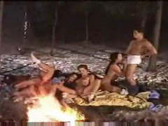 Group sex by the fire in the snow