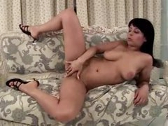 Curvy girl masturbates on the comfy daybed