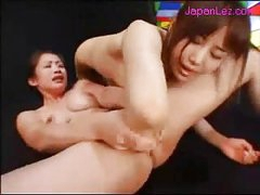 Asian Girl Getting Her Pussy Fingered While Fisting Other Girl Pussy Rubbing In Scissor On The Mattress