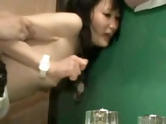 Asian pair in bathroom