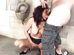 dirty cougar slut fucking in a public toilet