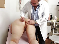 fat blonde getting her mature vagina examined