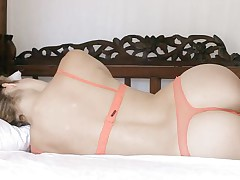 blonde gal with perfect arse relaxing on the bed