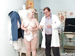 old slut is being checked by her gynecologist.