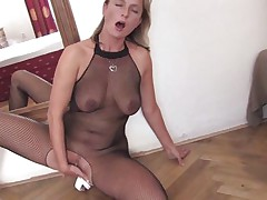 mature blonde masturbating on the floor with a dildo