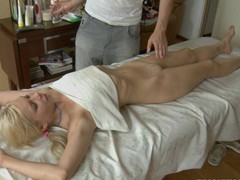 Perky nippled blond enjoys having her body rubbed with oil