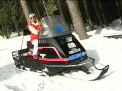 Coldresistant babe strips on snowmobile