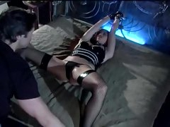 Bondage and sex in a rubber corset and stockings