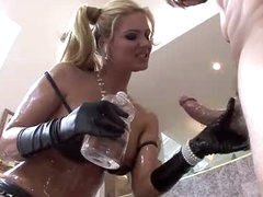 An oiled up Phoenix Marie sucks big knob