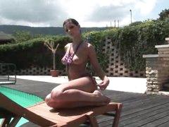 Hottie in a bikini positions poolside