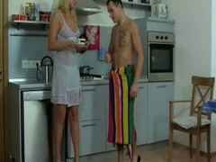 Blond milf gets nailed in the kitchen